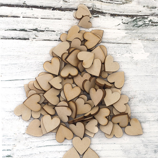 Wooden hearts in Christmas tree pattern