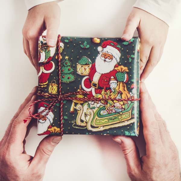 Hands giving Christmas gift