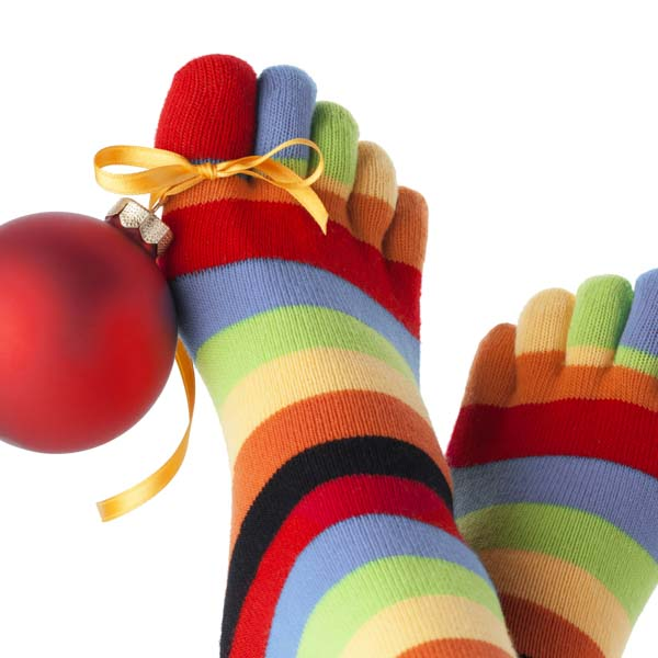 Christmas ornament tied to feet wearing rainbow socks
