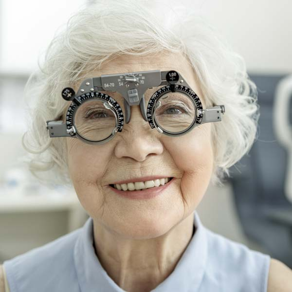 Woman wearing funny glasses at optometrist's office