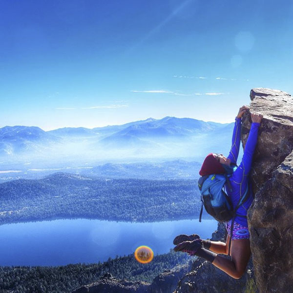 Mountain climber hanging on cliff