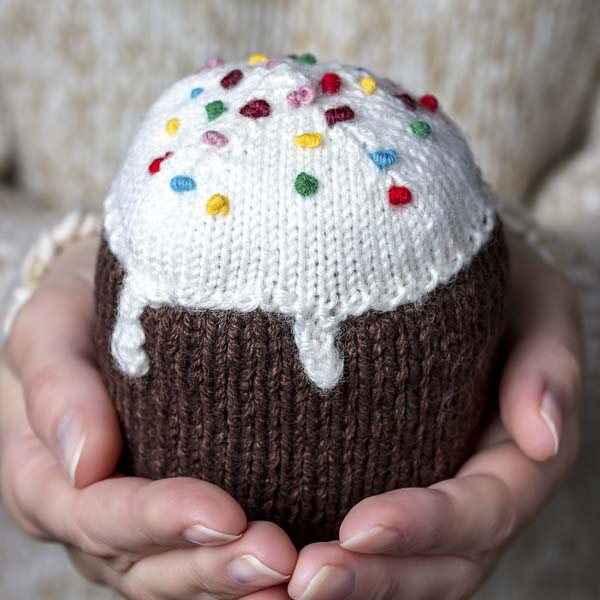 Hand-knitted cupcake with sprinkles