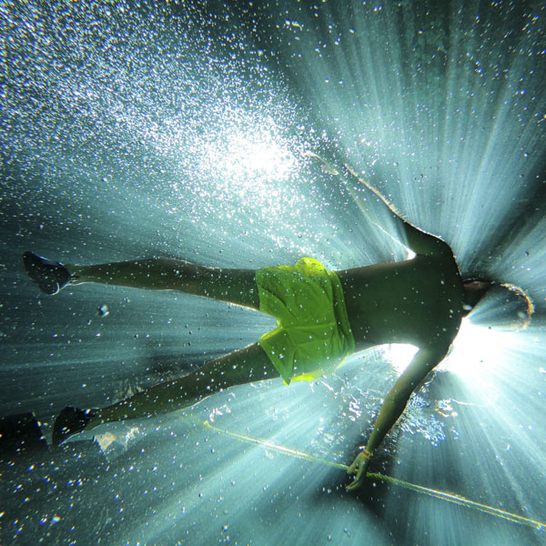 Man floating in light-infused water