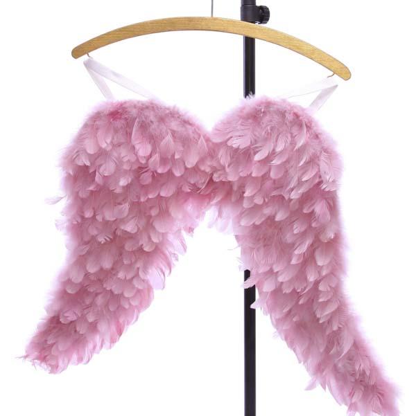 Pink angel wings on coat hanger