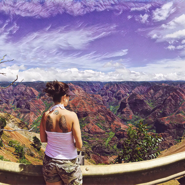 Woman standing at Waimea Canyon Lookout