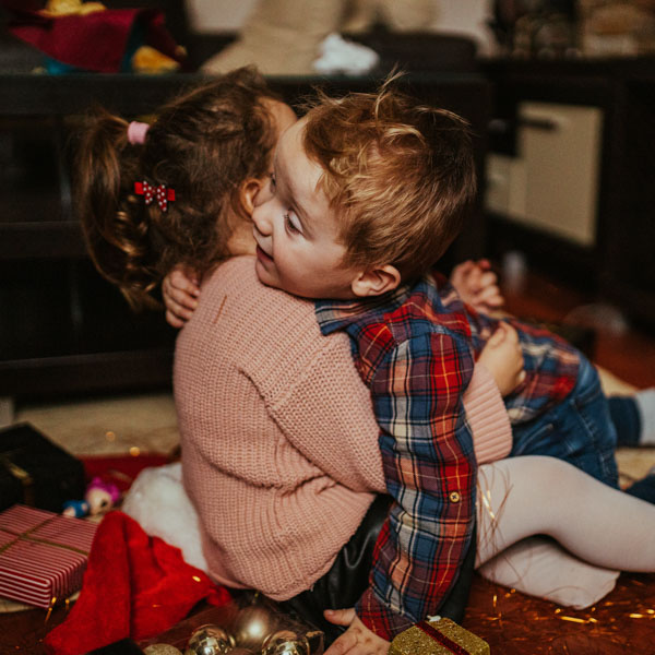 Sister and brother in sweet embrace