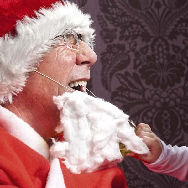 Child pulling Santa's cotton beard