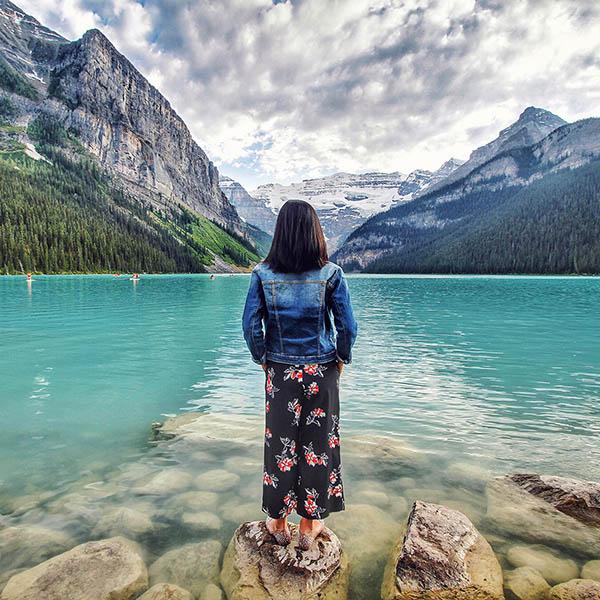 Woman looking at glacier lake