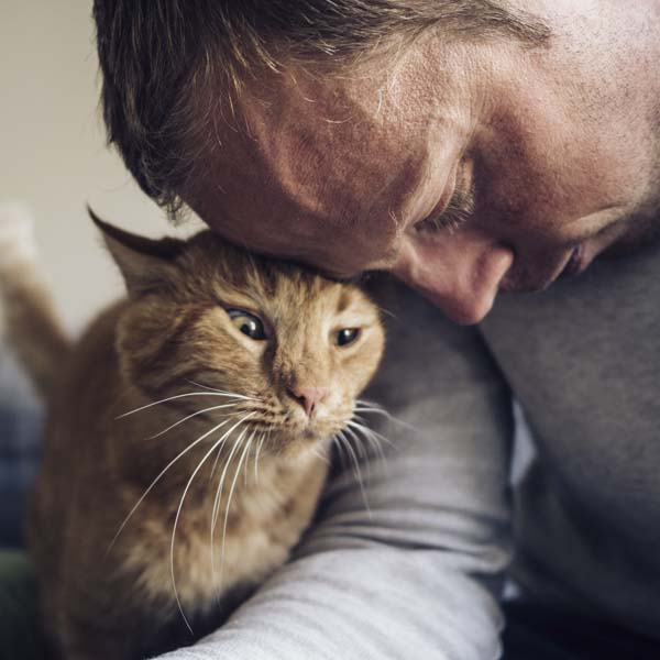Man and cat sharing love