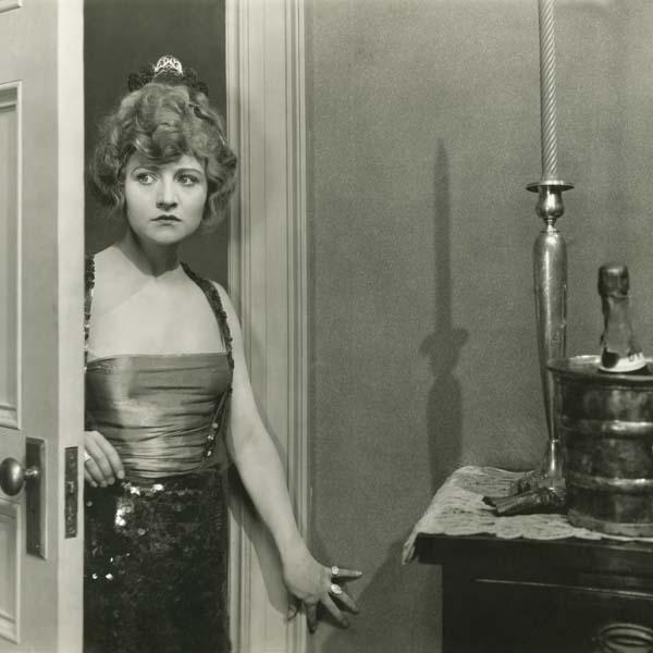 Vintage woman opening the door