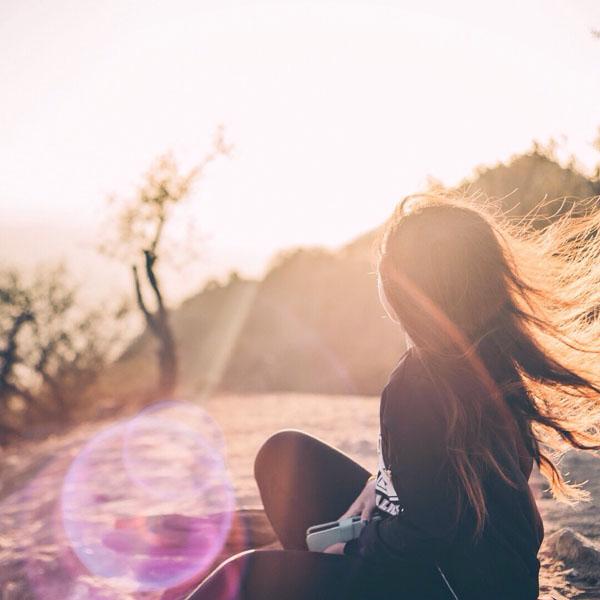 Girl sitting in sunbeam