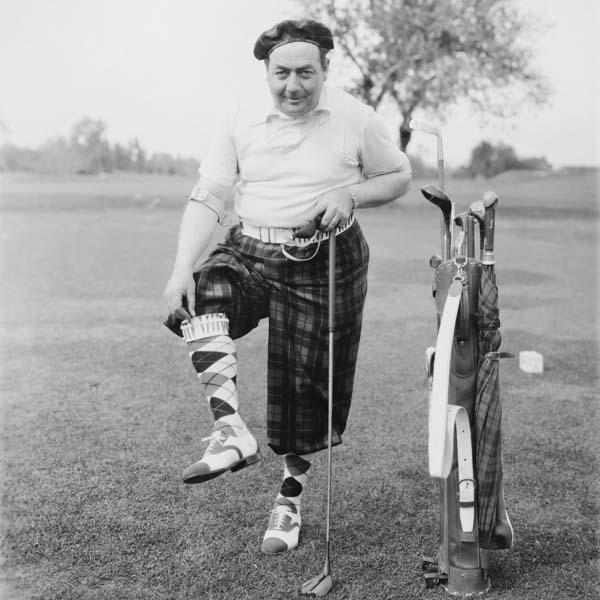 Vintage man wearing fashionable golf attire and tee socks