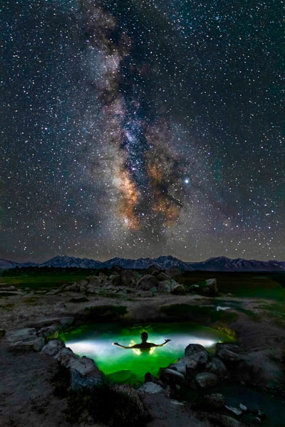 Human being in hot springs gazing at the stars