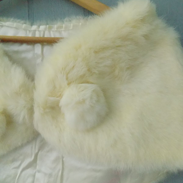 Vintage fur wrap on wood hanger