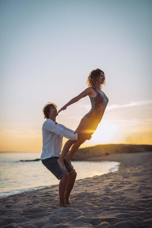 Man lifting woman up