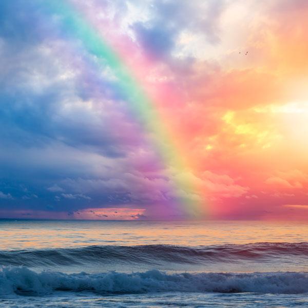 Rainbow over waves