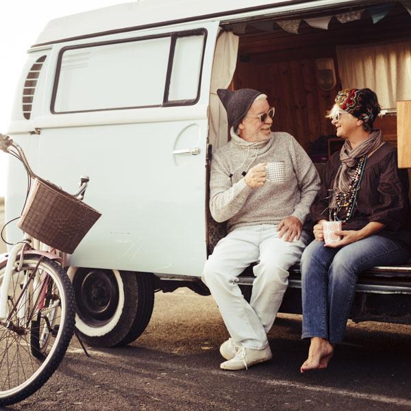 Older couple sitting in van