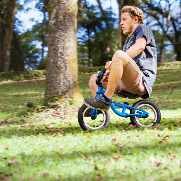 Simon riding a kid's bike