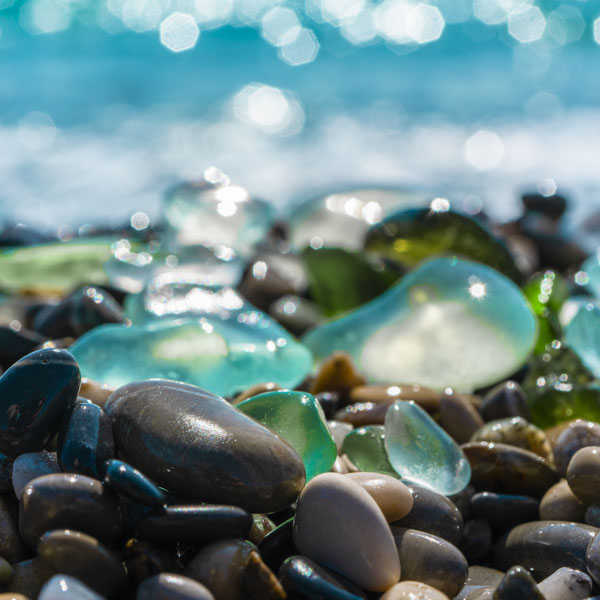 Rounded rocks and beach glass on the beach