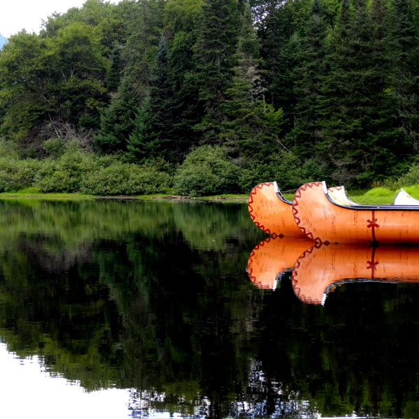 Two canoes on peaceful lake