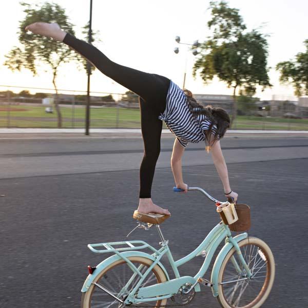 Woman riding cruiser beach bicycle
