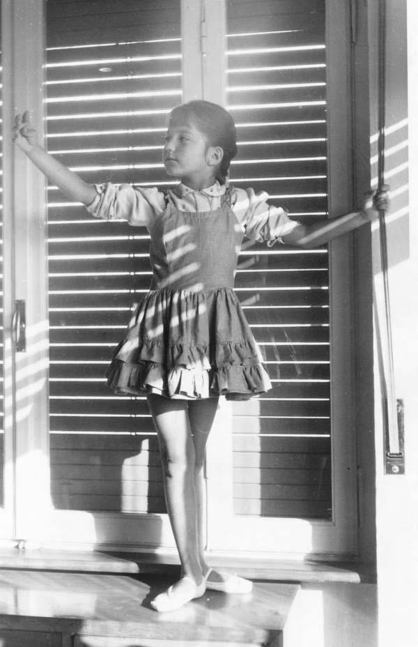 Ballerina standing in light