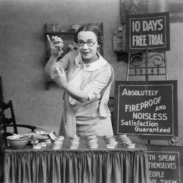 Vintage woman selling false teeth
