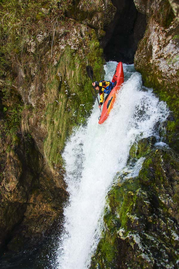 Kayak heading over cliff