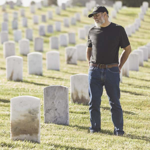 Vietnam veteran standing in cemetery