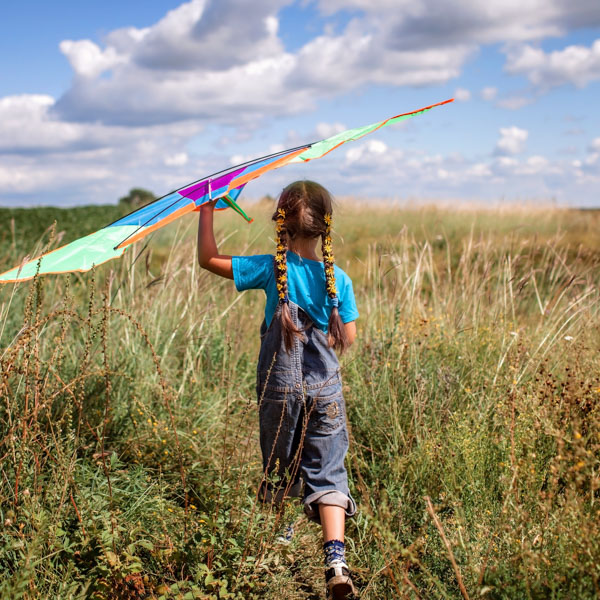 Little girl in field with her kite