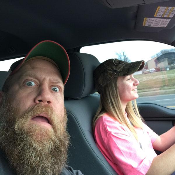 Dad teaching daughter to drive