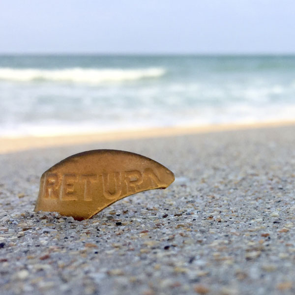 Piece of beach glass with return embossed