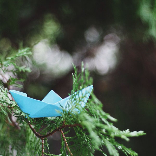 Paper sailboat in tree