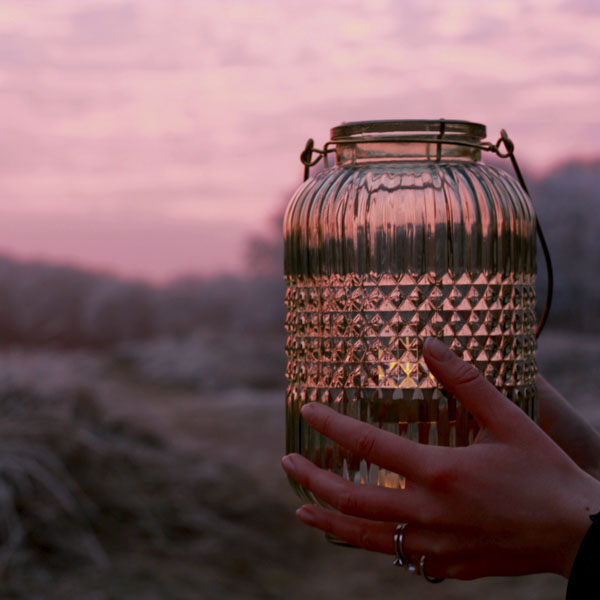 Holding a jar to capture the sunset