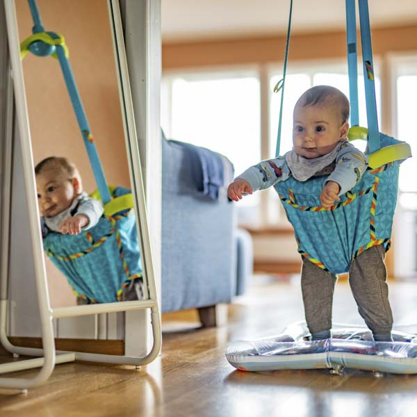Baby hanging in jumper
