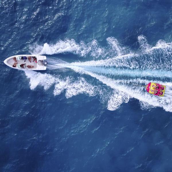 Boat pulling people on float