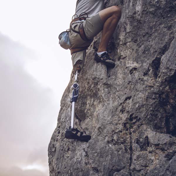 Heroic amputee rock climbing