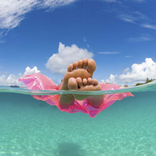 Person in pink float on the ocean