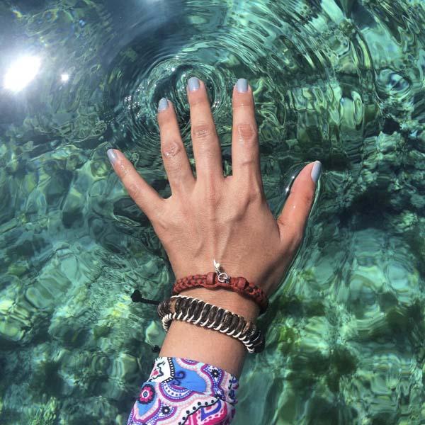 Hand feeling water