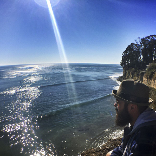 Contemplative man looking out at ocean