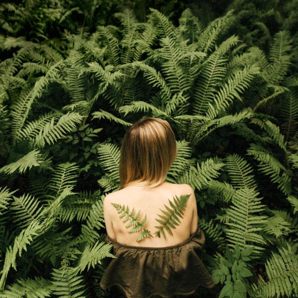 Woman with fern angel wings