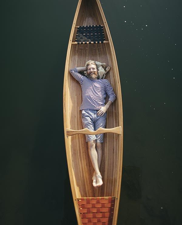Man relaxing in canoe