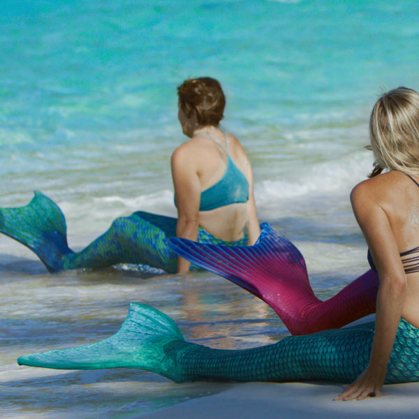 Mermaids scooting down to the water