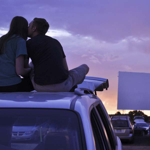 Couple at drive-in theater