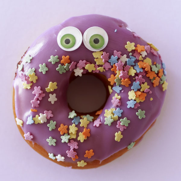 Purple donut with sprinkles