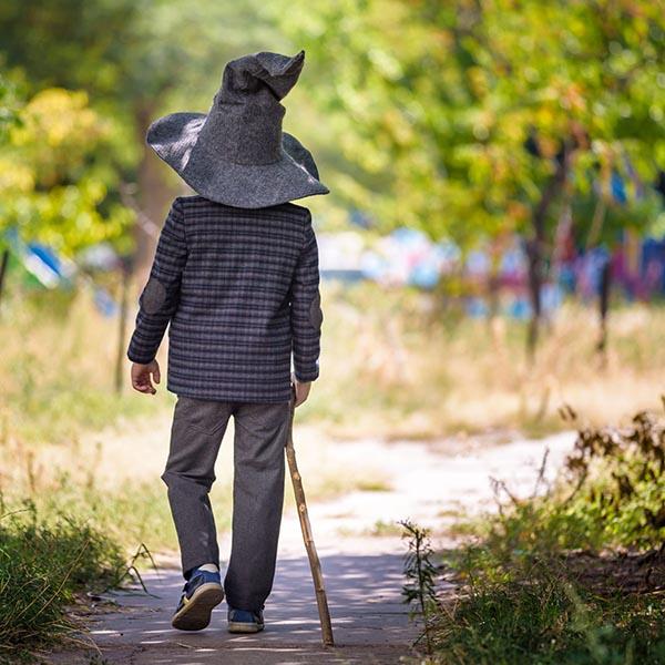 Boy walking in wizard hat
