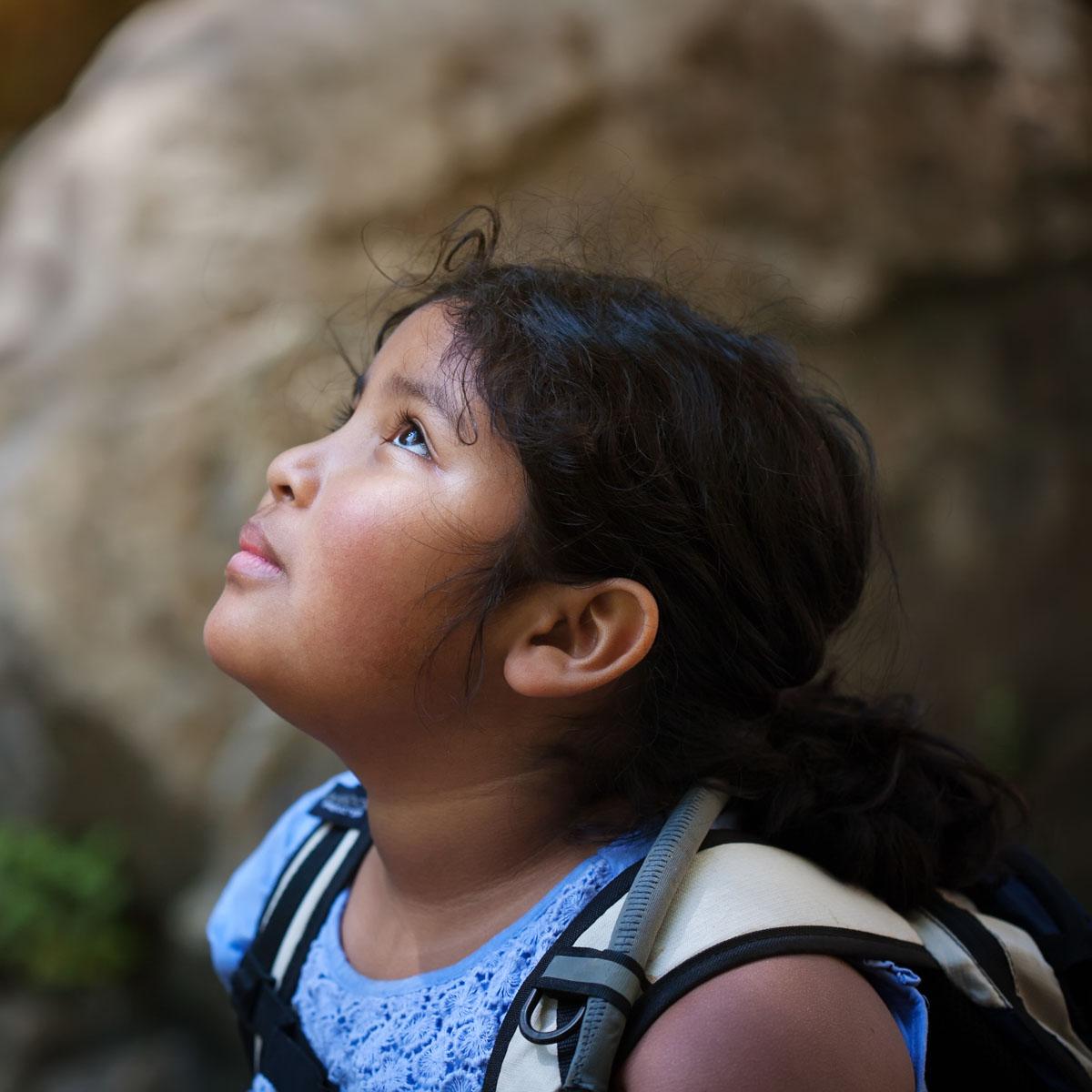 Girl looking up at sky