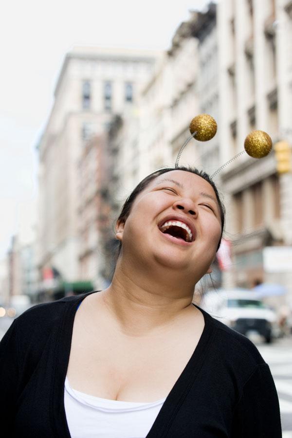 Woman in alien headband laughing